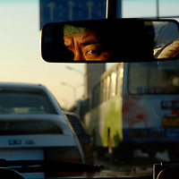 Taxi driver stuck in a rush hour  traffic jam on Jiangguomen Wai.<br /> <br /> From China [sur]real &not;&copy; Mark Henley