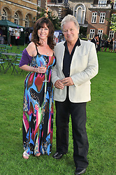 VICKI MICHELLE and her husband GRAHAM FOWLER at The Lady Taverners 25th Anniversary Westminster Abbey Garden Party held in The College Gardens, Westminster Abbey, London o 11th July 2012.