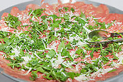 party outdoors, tasty appetizer, carpaccio with rocket