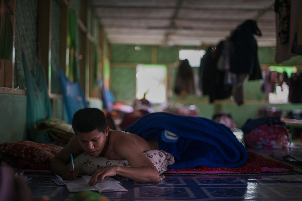 20170226 Myitkyina<br /> A boy does writes in a notebook in a drug rehabilitation center in Myitkyina, Kachin State, Myanmar.<br /> Photo: Vilhelm Stokstad / Kontinent