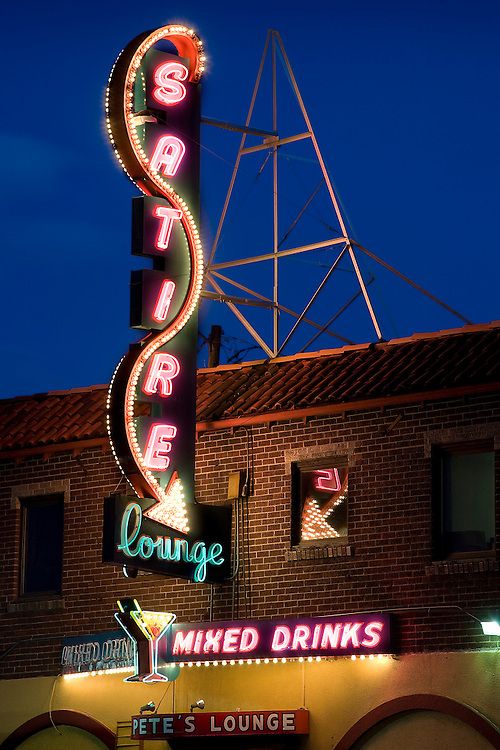 Classic neon on Denver's Colfax Avenue.  The Satire Lounge has a long history, seeing such then-unknowns as Bob Dylan and the Smothers Brothers perform in the early 1960's.