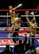 Amir Khan celebrates after the final bell. WBA Light Welterweight title fight between Amir Khan (Challenger) and Andreas Kotelnik (Champion) at the MEN Arena on July 18, 2009 in Manchester, England.