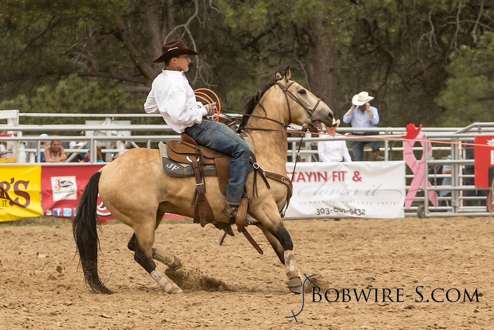 Heeler JC Flake makes his team roping run during the third performance of the Elizabeth Stampede on Sunday, June 3, 2018.