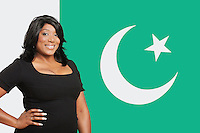 Portrait of casual mixed race woman against Pakistani flag