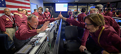 """Hand Out - Tom Hoffman, InSight Project Manager, NASA JPL, left, and Sue Smrekar, InSight deputy principal investigator, NASA JPL, react after receiving confirmation that the Mars InSight lander successfully touched down on the surface of Mars, Monday, November 26, 2018 inside the Mission Support Area at NASA's Jet Propulsion Laboratory in Pasadena, California. InSight, short for Interior Exploration using Seismic Investigations, Geodesy and Heat Transport, is a Mars lander designed to study the """"inner space"""" of Mars: its crust, mantle, and core. Photo by NASA/Bill Ingalls via ABACAPRESS.COM"""
