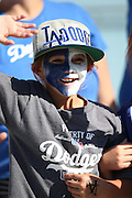 LOS ANGELES, CA - MAY 28:  A young fan cheers before the Los Angeles Dodgers game against the Cincinnati Reds at Dodger Stadium on Wednesday, May 28, 2014 in Los Angeles, California. The Reds won the game 3-2. (Photo by Paul Spinelli/MLB Photos via Getty Images)