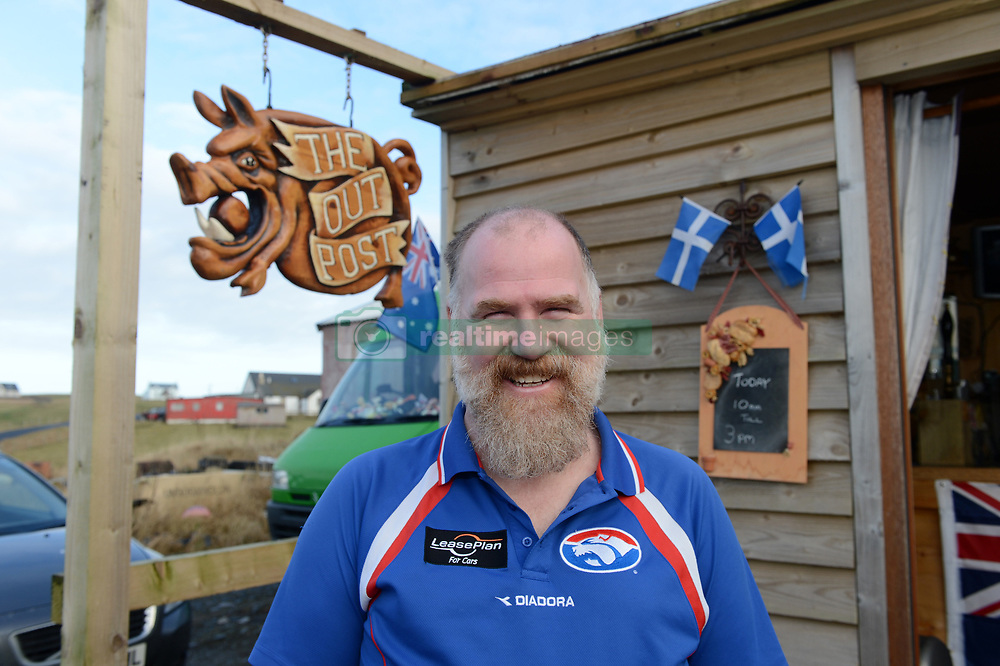 EXCLUSIVE: An Australian man has created his own Outback outpost 11,000 miles from home on the Shetland Islands – and he even has WALLABIES. Tasmanian Dave Kok, 42, has built his own Aussie oasis on the Scottish archipelago after deciding to settle there when he was travelling Europe. Now Dave lives with his Shetland native wife Louise, 38, and two daughters Caitlin, 11, and Ruby, aged four. Social care worker Dave came to the islands in the late 90s and since 2016 has been building his own watering hole choc-full of Australiana on the island of Burra. Dave's place 'The Outpost' is a renovated wooden porta cabin filled with Tasmanian beers, Tim Tams, books on bush craft and Aussie Rules sporting memorabilia. Locals use the Outpost as their local bar and meeting place, as the nearest pub or café is three bridges and three islands away. And visitors can now enjoy the Outpost's wallabies Ned and Kelly who David brought to the island this winter. Based on the Shetland Islands latitude the marsupials could be the most northerly of their species anywhere on the planet. Dave said visiting Australians are often surprised to find the antipodean paradise in such a remote location. 16 Feb 2018 Pictured: Pic from Dave Donaldson/ Magnus News Agency. Pic shows David Kok outside his Aussie-themed Outpost in the Shetland Islands. An Australian man has created his own Outback outpost 11,000 miles from home on the Shetland Islands – and he even has WALLABIES. Tasmanian David Kok, 42, has built his own Aussie oasis on the Scottish archipelago after deciding to settle there when he was travelling Europe. Now David lives with his Shetland native wife Louise and two daughters Caitlin, 11, and Ruby, aged four. Social care worker David came to the islands in the late 90s and has built his own watering hole choc-full of Australiana on the island of Burra. David's place 'The Outpost' is a renovated wooden porta cabin filled with Tasmanian beers, Tim Tams, books on bush cra