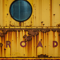 Rusty painted metal with oval and lettering ROAD