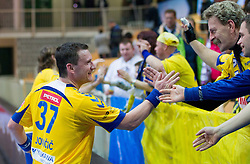 Zoran Jovicic of Cimos Koper with fans 12. Kopra after the handball match between RK Cimos Koper and HCM Constanta in 10th Round of season 2011/2012 of EHF Men's Champions League, on February 25, 2012 in Arena Bonifika, Koper, Slovenia. Cimos Koper defeated Constanta 28-24. (Photo By Vid Ponikvar / Sportida.com)