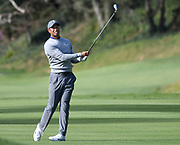 Tiger Woods hits a shot from the 17th fairway. Woods returned to Riviera Country Club to get in a practice round before the Genesis Open. It is Woods first return to Riviera in a number of years. The tournament begins on Thursday. Pacific Palisades, CA 1/13/2018 (Photo by John McCoy)