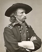 George Armstrong Custer (1839-1876) United States Army office and cavalry commander in American Civil War and Indian Wars. Defeated and killed at Battle of Little Bighorn in what iscalled Custer's Last Stand.  Photograph.