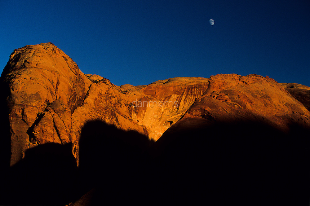 Moonrise over red sandstone bluff, Cayote Gulch, Escalante National Monument, Utah