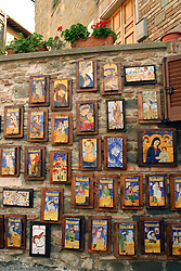 Deruta:  Souvenir-size samples of Derutan pottery, produced by Carlo Favaroni, decorate a wall outside of his shop.