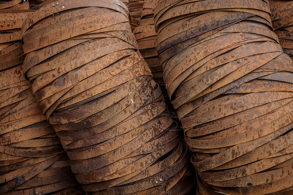 Rings await placement on barrel staves at Speyside Cooperage, Craigellachie, Scotland, July 13, 2015. Gary He/DRAMBOX MEDIA LIBRARY