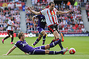 Tottenham Hotspur forward Harry Kane and Sunderland Defender John O'Shea tangle during the Barclays Premier League match between Sunderland and Tottenham Hotspur at the Stadium Of Light, Sunderland, England on 13 September 2015. Photo by Simon Davies.