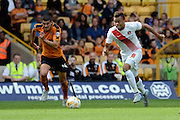 Jordan Cousins attacks watched Conor Coady during the Sky Bet Championship match between Wolverhampton Wanderers and Charlton Athletic at Molineux, Wolverhampton, England on 29 August 2015. Photo by Alan Franklin.