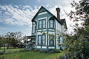 Compass Rose Bed & Breakfast. Coupeville, Washington, USA. This fine 1890 Queen Anne Victorian home, on the National Register of Historic Places, is now an elegant two room bed and breakfast, furnished with antiques and glorious things from around the globe by the hosts, Captain and Mrs. Marshall Bronson.