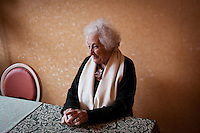 Sesta Godano, Italy - 16 January, 2013:  Caterina Pezzi, 80, elementary teacher of the territory of Varese Ligure, in Sesta Godano, Italy, on 16 January, 2013. <br /> <br /> Sesta Godano is a town in the province of La Spezia, in the Liguria region, with a population of about 1,400.  Because of a low number of children in the area, students in the elementary and seconday have been grouped in multigrade classes. According to the ISTAT (Italian National Statistical Institute) Liguria is the oldest of the Italian regions, with the highes ageing index of 232 percent compared to the national average of 144,5 percent and the EU average of 111,3 percent (data is from 2010). The average age in Liguria is 48 years old. <br /> <br /> Italy is ageing. According to ISTAT, the average age will rise from 43.5 in 2011 to a maximum of 49.8 in 2059.
