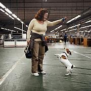 Antonella Marano 47 anni, operaia e delegata RSU FEMCA CISL per la Tacconi Sud di Latina, è ritratta mentre fa giocare il suo cane Totò all'interno del capannone della fabbrica tessile occupata. Antonella è operaia specializzata addetta alla macchina da cucire e all'incollaggio e raspatura dei tessuti gommati. L'occupazione e' iniziata il 19 gennaio 2011 a seguito della comunicazione del licenziamento di tutti i dipendenti. La produzione dell'impianto e' ferma e l'intento delle donne e' quello di salvaguardare i materiali ancora al suo interno e di chiedere garanzie per il loro futuro lavorativo. Antonella Marano ha lavorato alla Tacconi Sud per 20 anni. Ha trovato un altro impiego a tempo determinato in un'altra fabbrica tessile di Latina.