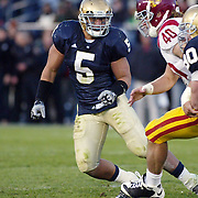 Notre Dame linebacker, Manti Teo prepares to fight off USC H Back, Rhett Ellisonn the 2009 Trojan 34-27 victory over the Irish.  Photo by Barry Markowitz, 10/17/09, 5pm