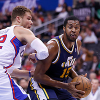 23 October 2013: Utah Jazz power forward Derrick Favors (15) drives past Los Angeles Clippers power forward Blake Griffin (32) during the Los Angeles Clippers 103-99 victory over the Utah Jazz at the Staples Center, Los Angeles, California, USA.