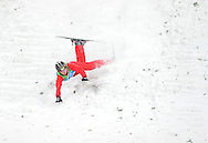 epa02048587 China's Guanqpu Qi crashes after the Men's Aerials qualification in the Freestyle Skiing at the Vancouver 2010 Olympic Games on Cypress Mountain near Vancouver, Canada, 22 February, 2010.  EPA/ANDREW GOMBERT