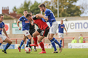 Morecambe Striker Cole Stocktonl and Carlisle United Macaulay Gillesphey battle during the EFL Sky Bet League 2 match between Morecambe and Carlisle United at the Globe Arena, Morecambe, England on 8 October 2016. Photo by Pete Burns.