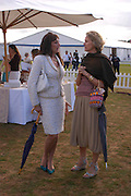 Angelica Huston and Mrs. Arnaud Bamberger. Cartier International Day at Guards Polo Club, Windsor Great Park. July 24, 2005. ONE TIME USE ONLY - DO NOT ARCHIVE  © Copyright Photograph by Dafydd Jones 66 Stockwell Park Rd. London SW9 0DA Tel 020 7733 0108 www.dafjones.com