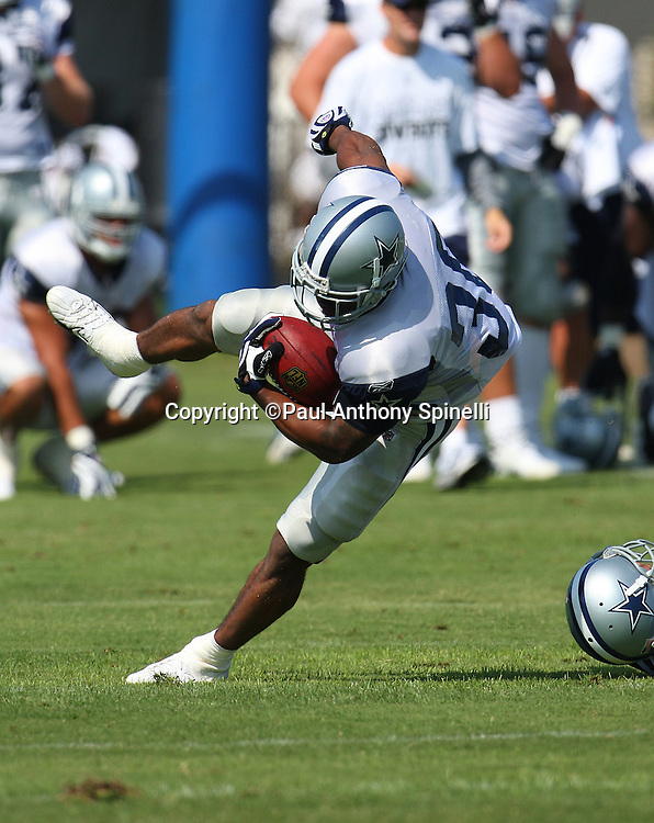 OXNARD, CA - JULY 26:  Running back Alonzo Coleman #30 of the Dallas Cowboys gets tripped up while running the ball during the 2008 Dallas Cowboys Training Camp at River Ridge Field in Oxnard, California on July 26, 2008. ©Paul Anthony Spinelli *** Local Caption *** Alonzo Coleman