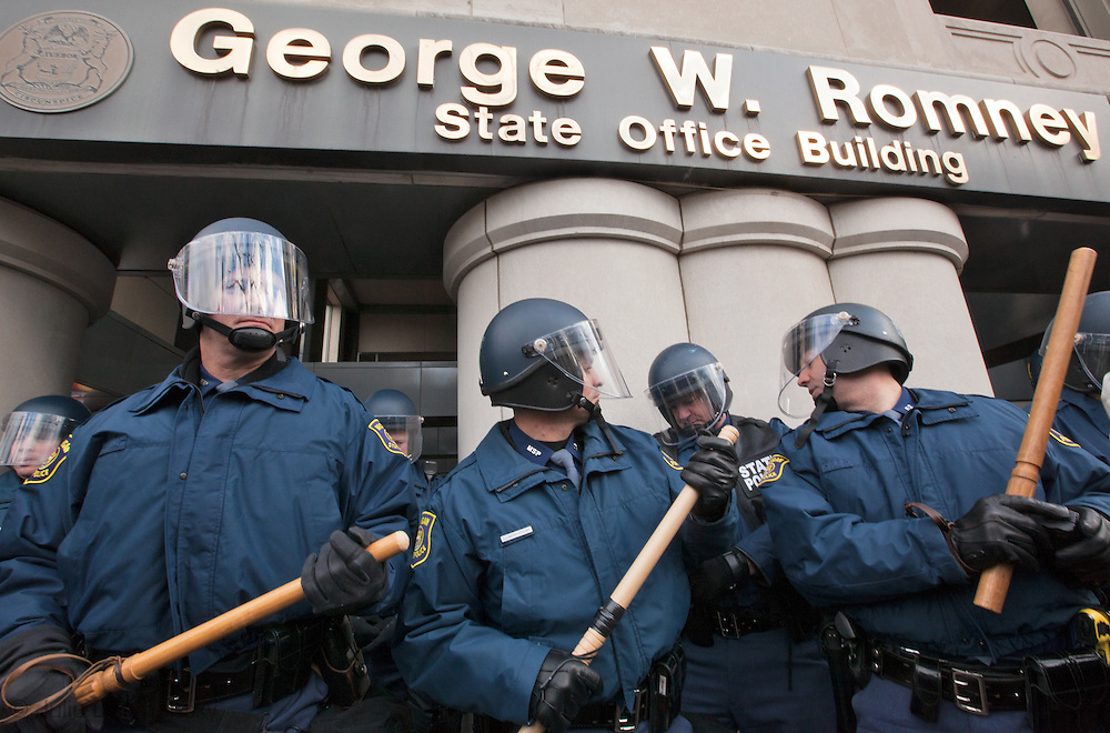 December 11, Lansing MI, Michigan .  Riot police block protesters in front of the George W. Romney building  during a union protest against the Right to Work law because they say it will hurt the middle class by lowering workers wages.