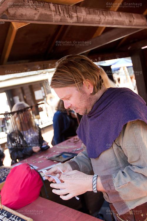 Fra historisk marked, Olavsfestdagene 2011...Dan Axel Jönsson fra Malmø..Dan Axel lager og selger ildstål, brynesteiner og armbånd. Han er med på Olavsfestdagene for femte gang..