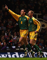Photo. Javier Garcia<br />12/02/2003 England v Australia, Friendly International, Upton Park<br />Tony Popovic celebrates his opener alongside Craig Moore