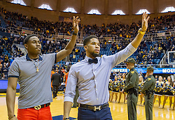West Virginia Mountaineers guard Juwan Staten (3) and West Virginia Mountaineers guard Gary Browne (14) wave to fans after their game against Oklahoma State at the WVU Coliseum.