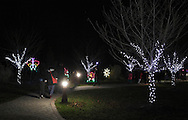 Hamptonburgh, New York - People walk through the Holiday Lights in Bloom display in the Orange County Arboretum at Thomas Bull Memorial Park on Dec. 1, 2011. The Holiday Lights in Bloom display features beautiful, garden-themed lights in the forms of flowers, animals, and insects.