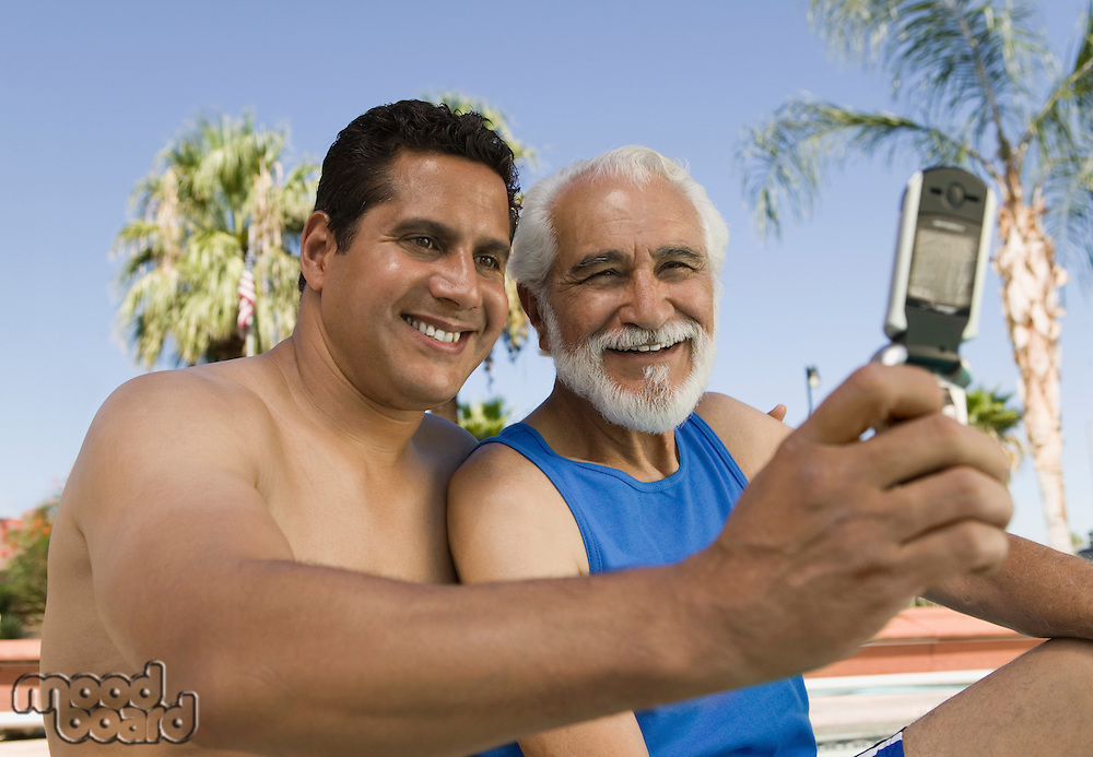 Senior Father and Son Taking Picture on Cell Phone
