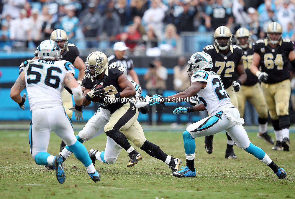 New Orleans Saints running back Mark Ingram (22) catches a fourth quarter pass for a first down as he gets chased down by Carolina Panthers middle linebacker A.J. Klein (56), Carolina Panthers outside linebacker Shaq Green-Thompson (54), and Carolina Panthers cornerback Bene' Benwikere (25) during the 2015 NFL week 3 regular season football game against the Carolina Panthers on Sunday, Sept. 27, 2015 in Charlotte, N.C. The Panthers won the game 27-22. (©Paul Anthony Spinelli)