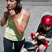 July 26, 2010 - Bronx, NY : Nina Habib Spencer picks up two and a half-year-old Teddy Spencer up from Riverdale Presbyterian Nursery School by bike on Monday afternoon.