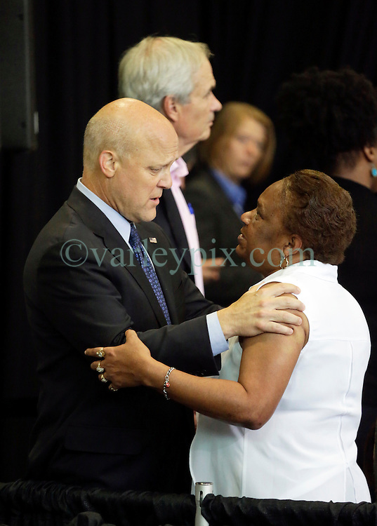 27 August 2015. Andrew P. Sanchez & Copelin-Byrd Multi Service Center, Lower 9th Ward, New Orleans, Louisiana.<br /> Mayor Mitch Landrieu speaks to a woman in the crowd before President Barack Obama speaks. <br /> Photo credit©; Charlie Varley/varleypix.com.