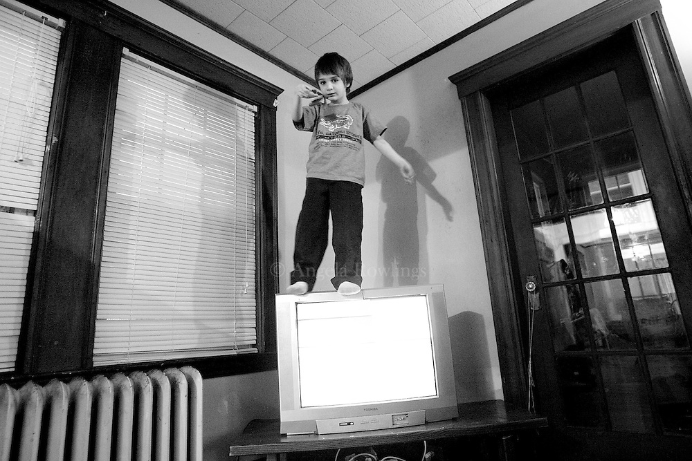 Aidan Sumner, 4, stands on his family's television set, Thursday,  February 28, 2008.  Aidan, who is a very active boy, especially likes climbing on furniture.