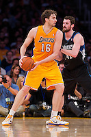16 March 2012: Forward Pau Gasol of the Los Angeles Lakers looks to pass while being defended by Kevin Love of the Minnesota Timberwolves during the first half of the Lakers 97-92 victory over the Timberwolves at the STAPLES Center in Los Angeles, CA.