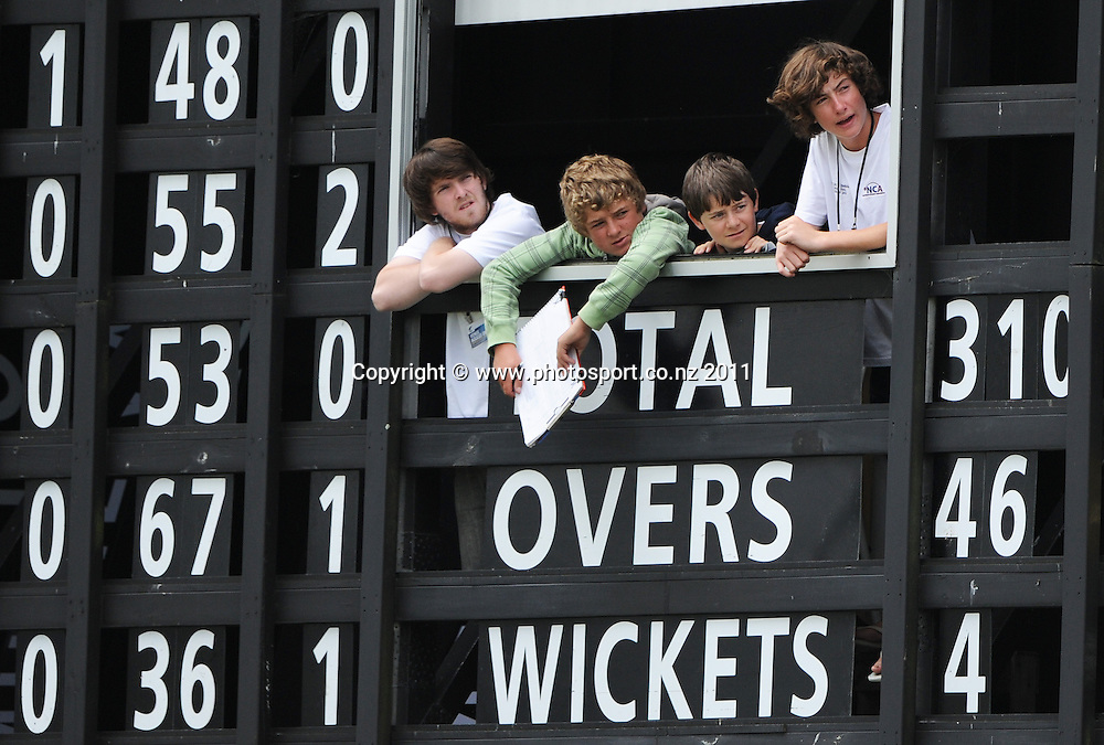 Scorers inside the scoreboard at the 2nd ODI cricket match between New Zealand and Zimbabwe at Cobham Oval in Whangarei, Monday 6 February 2012. Napier, New Zealand. Photo: Andrew Cornaga/Photosport.co.nz