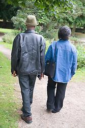 Older couple walking in the park together,