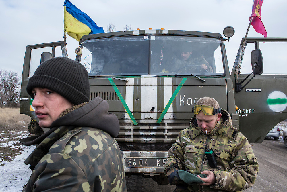 ARTEMIVSK, UKRAINE - FEBRUARY 19: Ukrainian soldiers from a unit based in Zaporizhia repair their trucks after withdrawing from Debaltseve the previous day on February 19, 2015 in Artemivsk, Ukraine. Ukrainian forces started withdrawing from the strategic and hard-fought town of Debaltseve yesterday being effectively surrounded by pro-Russian rebels. (Photo by Brendan Hoffman/Getty Images) *** Local Caption ***
