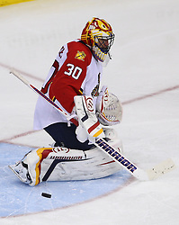 Feb 11; Newark, NJ, USA; Florida Panthers goalie Scott Clemmensen (30) makes a pad save during the third period at the Prudential Center. The Panthers defeated the Devils 3-1.
