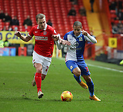 Blackburn Rovers striker, Simeon Jackson (35) running down wing battling with Charlton Athletic defender, Chris Solly (20) during the Sky Bet Championship match between Charlton Athletic and Blackburn Rovers at The Valley, London, England on 23 January 2016. Photo by Matthew Redman.