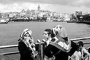 Woman talking on the phone near the Golden Horn at Eminonu, in Istanbul.