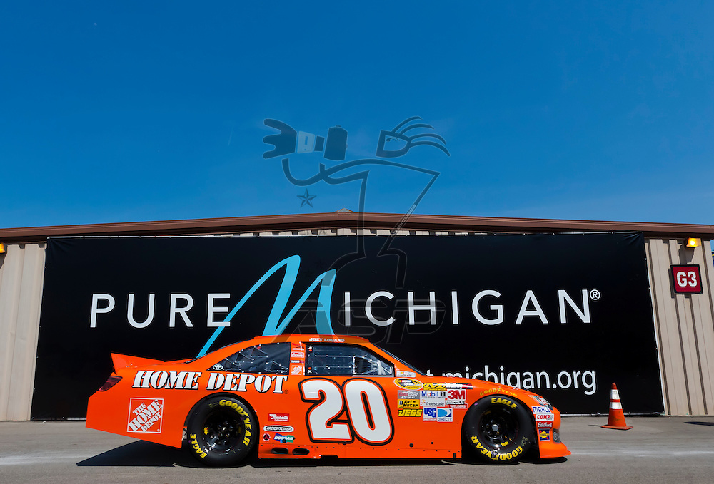 BROOKLYN, MI - JUN 15, 2012:  Joey Logano (20) brings his car back into the garage area during a practice for the Quicken Loans 400 at the Michigan International Speedway in Brooklyn, MI.
