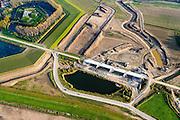Nederland, Noord-Brabant, Werkendam, 28-10-2014; Ruimte voor de Rivier project Ontpoldering Noordwaard. Boven in beeld Fort Steurgat, omgven door nieuwe dijk (primaire waterkering). De bandijk is reeds voorzien van een doorlaat annex brug. De Noordwaard wordt ontpolderd door de dijken aan de rivierzijde gedeeltelijk af te graven, hierdoor kan de Nieuwe Merwede bij hoogwater via de Noordwaard sneller naar zee stromen. Gevolg van de ingrepen is ook dat de waterstand verder stroomopwaarts zal dalen.<br /> National Project Ruimte voor de Rivier (Room for the River) By lowering and / or moving the dike of the Noordwaard polder the area will become subject to controlled inundation and function as a dedicated water detention district. Houses and farmhouses will be constructed on new dwelling mounds. <br /> luchtfoto (toeslag op standard tarieven);<br /> aerial photo (additional fee required);<br /> copyright foto/photo Siebe Swart