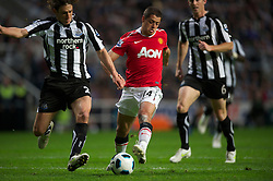NEWCASTLE, ENGLAND - Tuesday, April 19, 2011: Manchester United's Javier Hernandez and Newcastle United's Fabricio Coloccinni during the Premiership match at St James' Park. (Photo by David Rawcliffe/Propaganda)