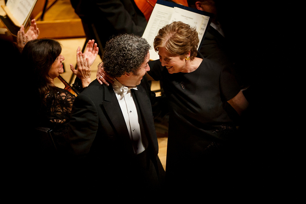 Outgoing LA Phil president Deborah Borda and conductor Gustavo Dudamel share a moment as she is honored during the LA Philharmonic performance at the Walt Disney Concert Hall on Thursday, May 18, 2017 in Los Angeles, Calif. The evening's performance featured Gustavo Dudamel's Schubert symphony as well as a tribute to outgoing president Deborah Borda, followed by a solo vocal from mezzo-soprano Sasha Cooke. © 2017 Patrick T. Fallon
